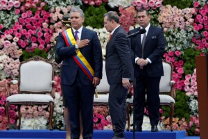 Colombia's new President Ivan Duque receives the presidential sash from President of the Senate Ernesto Macias, during his inauguration ceremony at the Bolivar Square