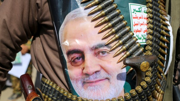 A supporter of the Houthis has a poster attached to his waist of Iranian Major-General Qassem Soleimani, head of the elite Quds Force, who was killed in an air strike at Baghdad airport, during a rally to denounce the U.S. killing, in Saada
