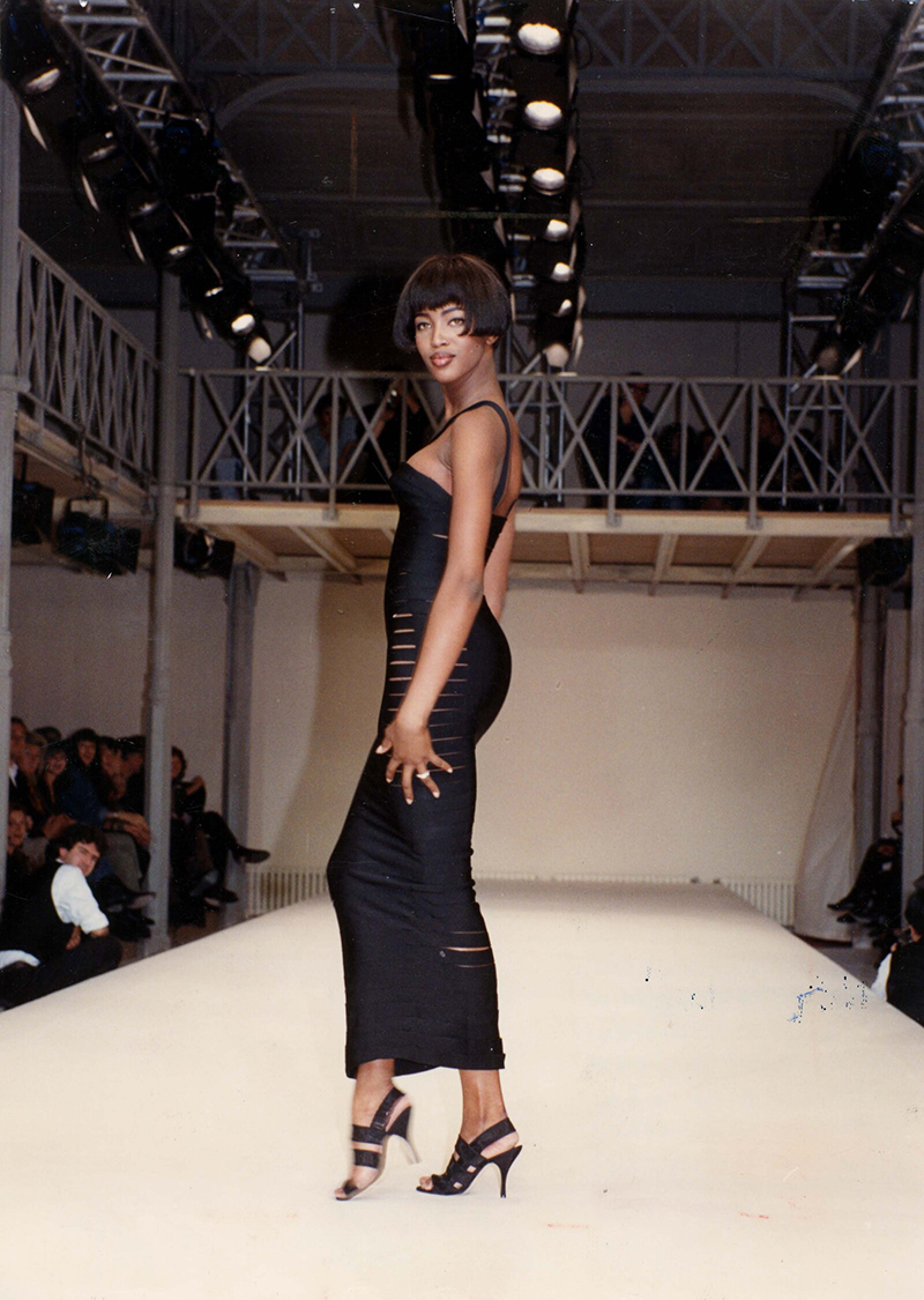 Naomi Cambpell Supermodel Is Pictured On The Catwalk Wearing A Black Dress Designed By Azzedine Alaia.