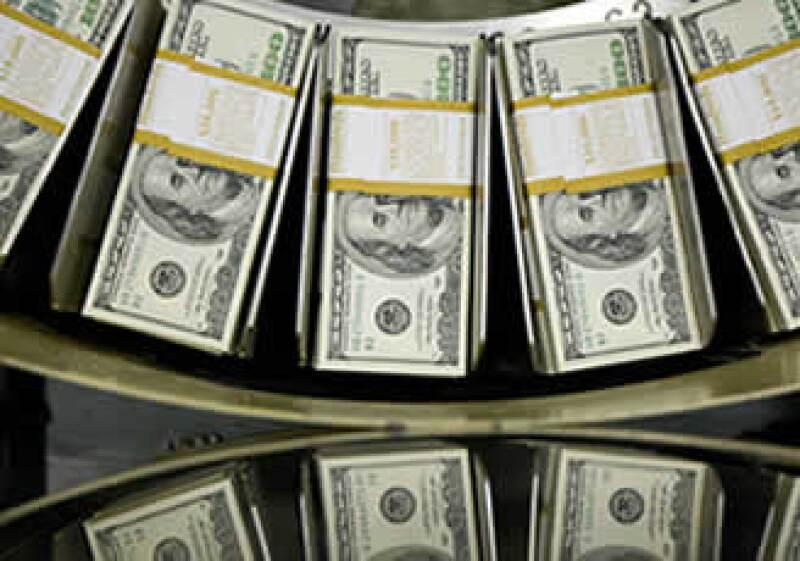 El 64% de las reservas de monedas del mundo están en dólares, según el FMI. (Foto: Cortesía Fortune)