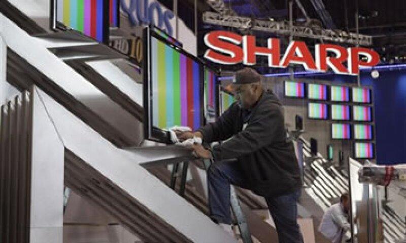 Sharp suministra pantallas a Apple para su más reciente versión del iPhone.  (Foto: AP)