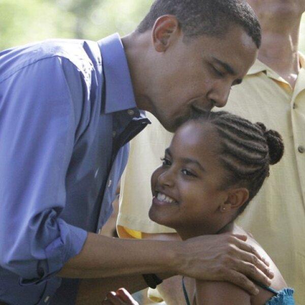 El presidente afroamericano con su hija Milia en julio de 2008,.