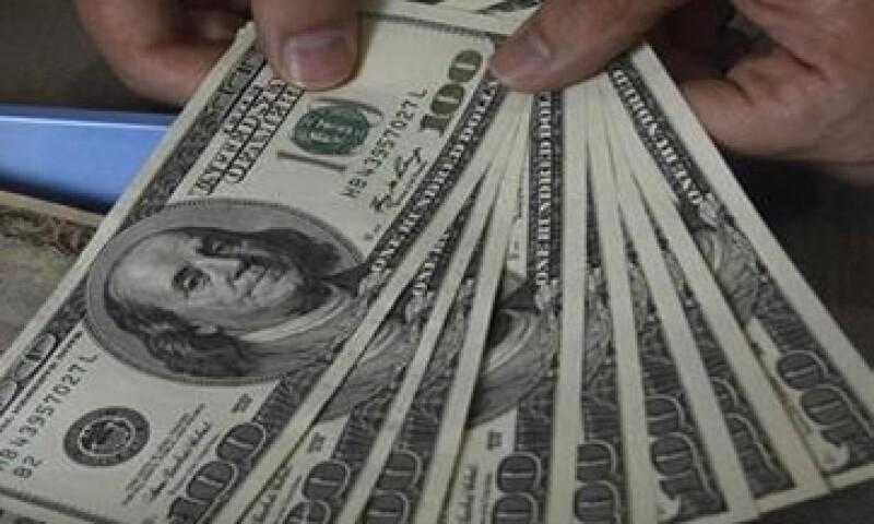 Banxico ubicó el tipo de cambio en 12.7753 pesos para solventar obligaciones denominadas en moneda extranjera. (Foto: Reuters)