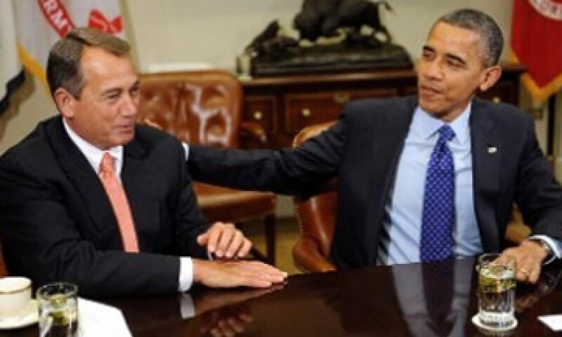 El presidente de la Cámara de Representantes, John Boehner y el presidente Barack Obama, difieren sobre sus planes para evitar el abismo fiscal. (Foto tomada de cnnmoney.com)