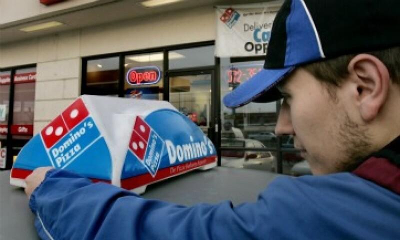 Domino's Pizza también ha aprovechado las redes sociales como Facebook. (Foto: AP)