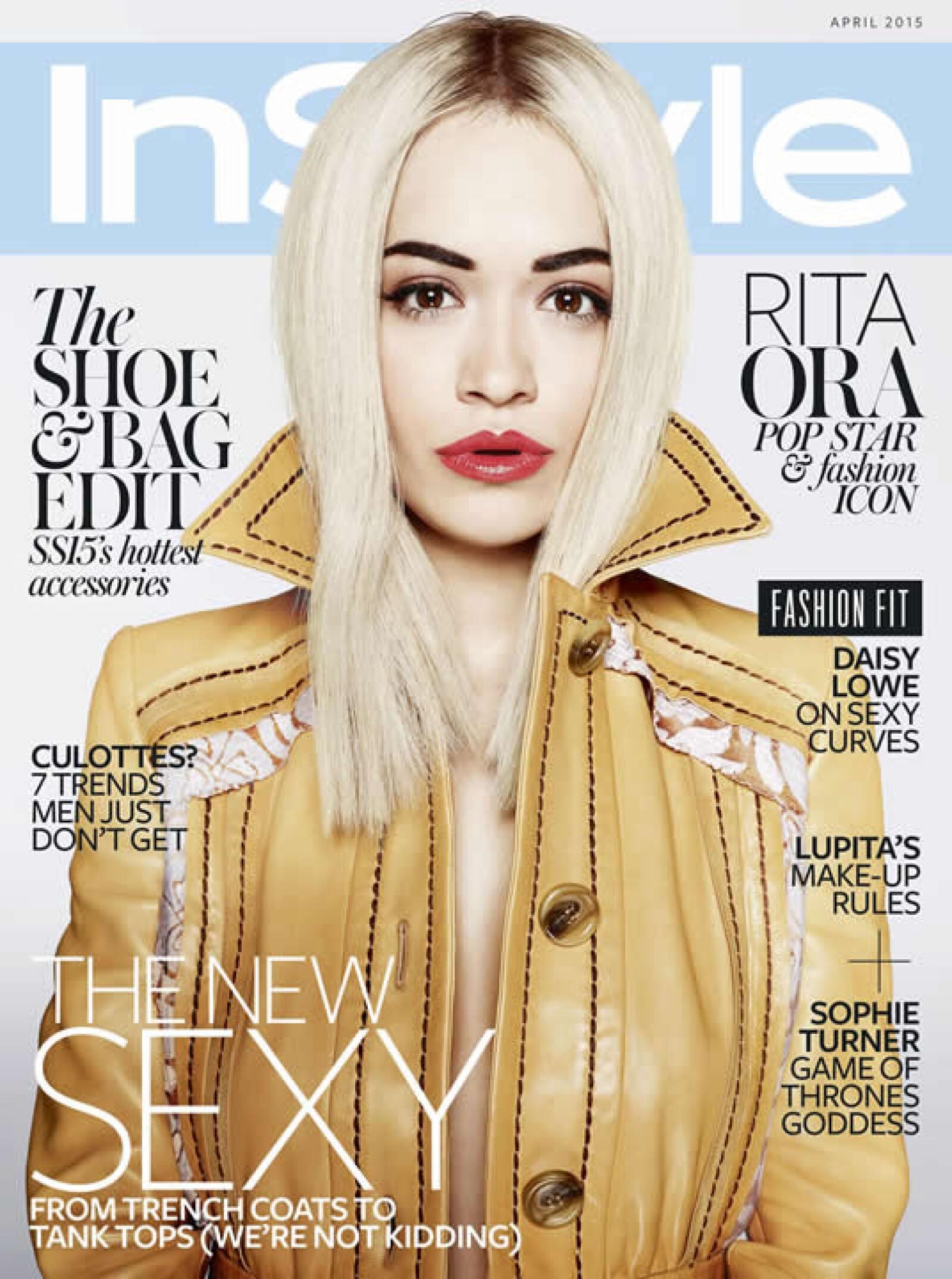 Para InStyle UK, Rita Ora fue fotografiada por Marcin Tyszka. Aparece con labios rojos y brillantes, cejas gruesas y una trenchcoat de piel amarilla de Prada, colección primavera verano 2015.