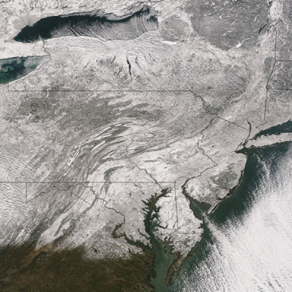 Una imagen tomada desde el espacio, el pasado 3 de enero de 2014, muestra un manto de nieve que se extiende desde la región del medio oeste de los Estados Unidos a través hasta Nueva Inglaterra.