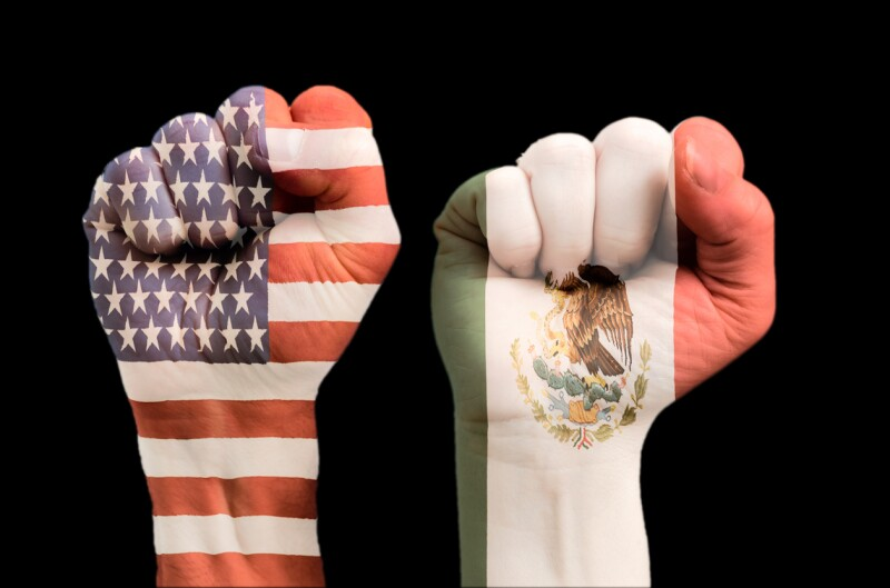 Two fists with embedded American and Mexican flag