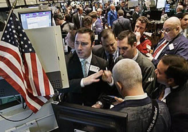 La recuperación económica en EU impulsó las acciones en Wall Street. (Foto: AP)