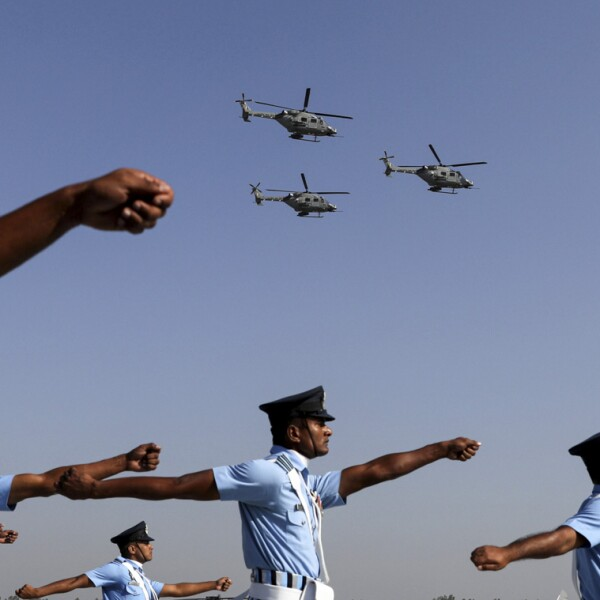 Indian Air Force (IAF) soldiers march as advanced light helicopters fly during the Indian Air Force Day celebrations at the Hindon Air Force Station on the outskirts of New Delhi