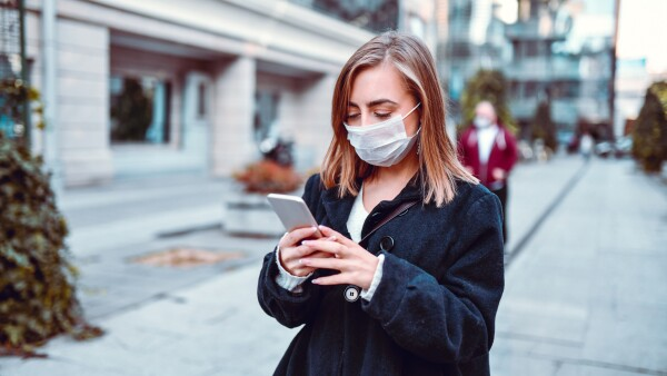 Female Finding Her Way On GPS While Wearing Anti Air Pollution Mask
