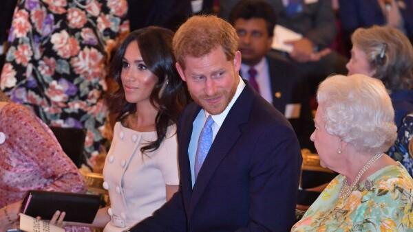 Meghan Markle, príncipe Harry y la reina Isabel II