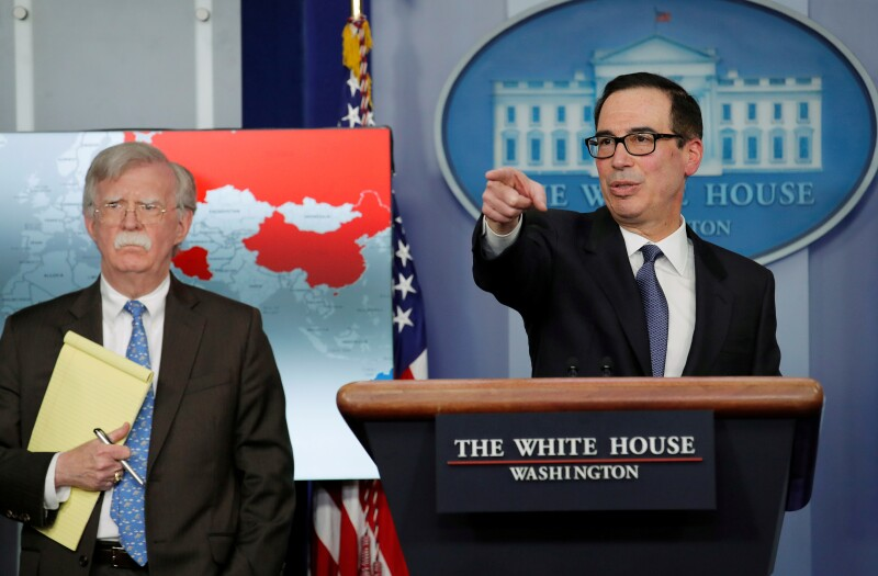 FILE PHOTO: Treasury Secretary Mnuchin and Security Advisor Bolton announce economic sanctions against Venezuela at the White House in Washington