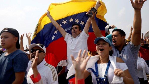 "People attend the ""Venezuela Aid Live"" concert at the Tienditas cross-border bridge between Colombia and Venezuela, in Cucuta"