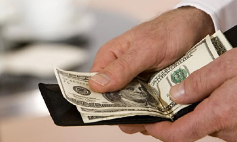 Analistas estiman que el tipo de cambio cotice entre 12.97 y 13.11 pesos en la jornada. (Foto: Getty Images)