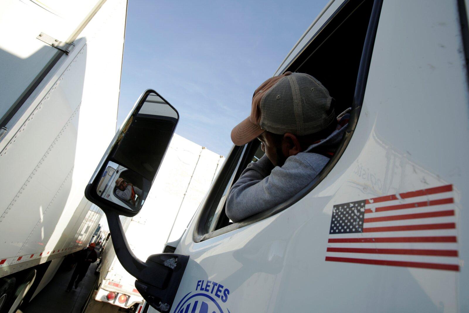 A truck driver waits in a long queue for border customs control to cross into U.S., at the Cordova-Americas border crossing bridge in Ciudad Juarez