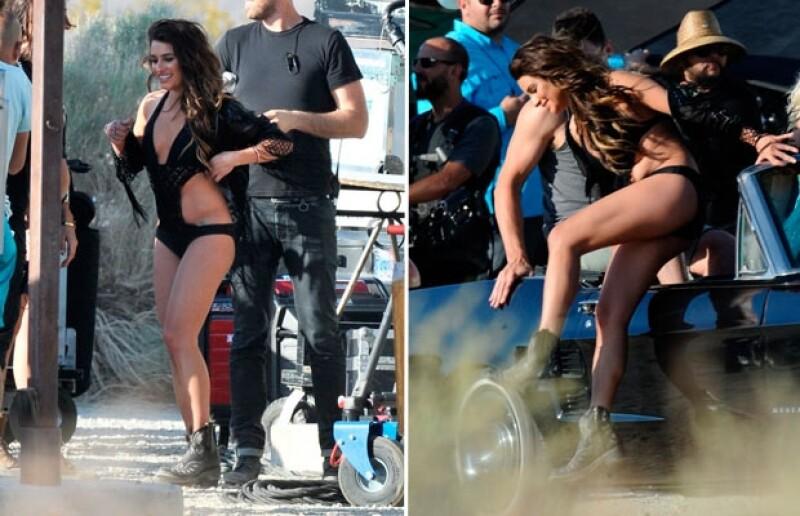 Lea lució su silueta en un traje de baño negro, con el que grabo escenas sobre un automóvil.