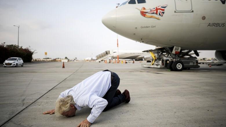 Virgin's Richard Branson kisses the ground as he lands at the Ben Gurion international airport near Tel Aviv