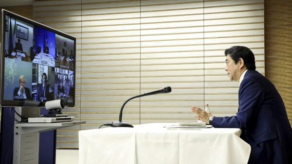 Japan's Prime Minister Shinzo Abe talks with other G7 leaders during a video conference at his official residence in Tokyo, Japan