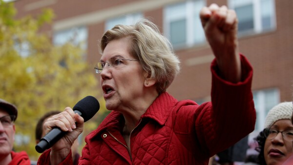 FILE PHOTO: Democratic presidential candidate Senator Elizabeth Warren speaks as she visits a picket line of striking teachers in Chicago