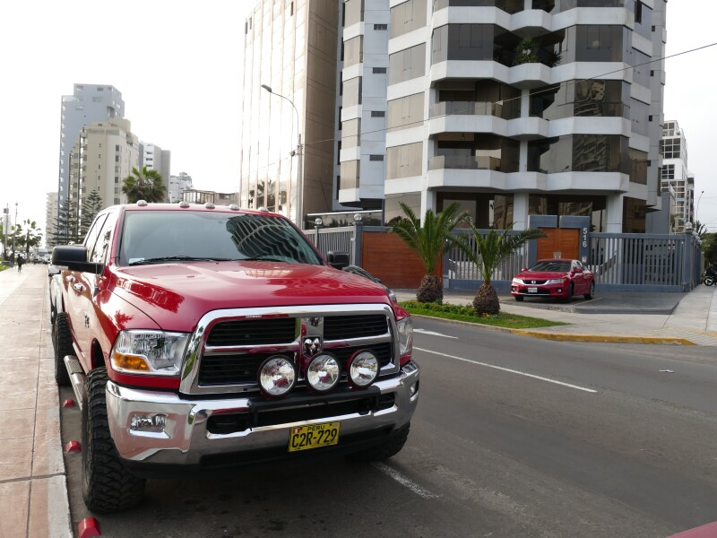 Red color mint condition full size four wheel drive pickup truck Dodge Ram 2500 Heavy Duty parked in Miraflores district of Lima.