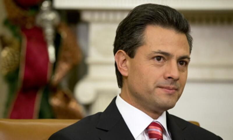 Enrique Peña Nieto deberá buscar la forma de apuntalar el crecimiento de la economía del país. (Foto: AP)