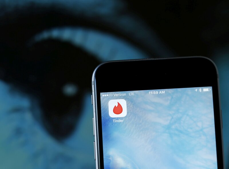 FILE PHOTO: Photo illustration of dating app Tinder shown on an Apple iPhone