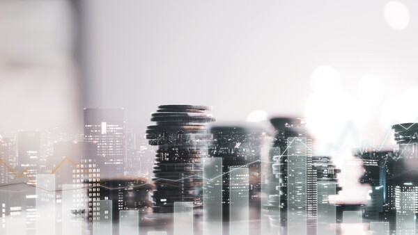 Double exposure of city view. diagram graph and rows of money coins for finance , money , investment and business concept background
