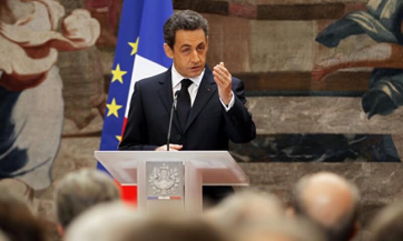 La rebaja de nota es un duro golpe para Nicolas Sarkozy, quien hizo de la nota máxima una especie de medalla de honor. (Foto: AP)