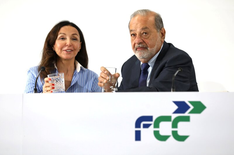 Mexican billionaire Carlos Slim and Esther Koplowitz, Deputy Chairman and second largest shareholder of the Spanish building and services group FCC, attend the presentation of the company's strategy plan in Madrid