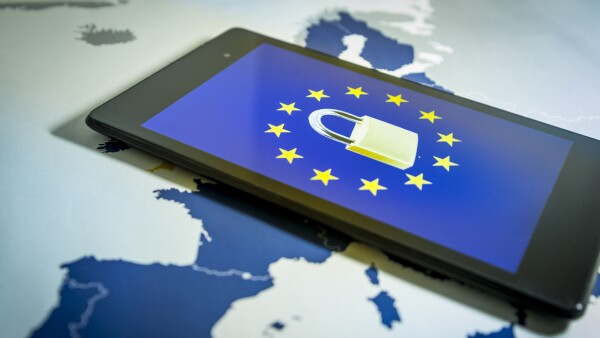 Padlock and EU flag inside a smartphone and EU map, GDPR metaphor