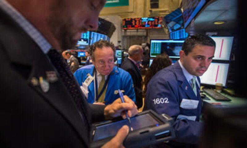 El índice industrial Dow Jones se vio afectado por los resultados de IBM y Goldman Sachs. (Foto: Getty Images)