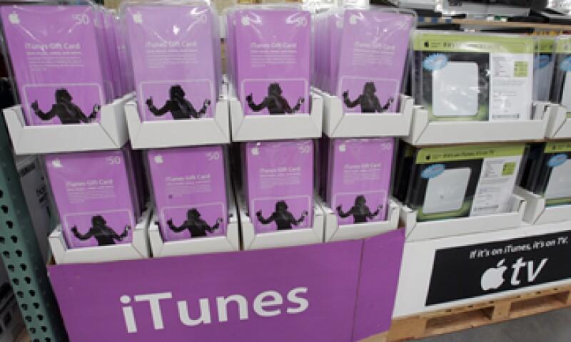 Apple acordó proporcionar créditos de 5 dólares en iTunes a hasta 23 millones de clientes afectados. (Foto: AP)