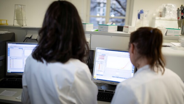 Charite hospital employees prepare a test for new coronavirus in Berlin