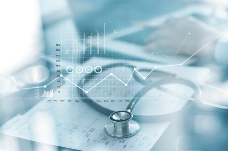 Healthcare business graph and Medical examination and businessman analyzing data and growth chart on blured background