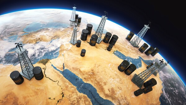 World globe Middle east, with oil barrels and drilling towers