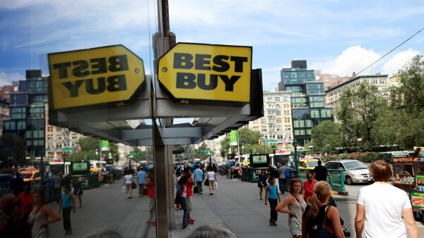 FILE PHOTO: People walk past a Best Buy store in New York