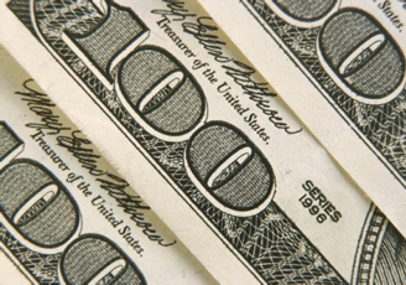 En ventanillas de bancos y casas de cambio, el peso operaba en 11.53 por dólar a la compra y en 11.93 a la venta. (Foto: Photos to go)