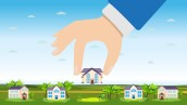 Vector of a hand picking up a house. Property for sale, real estate concept