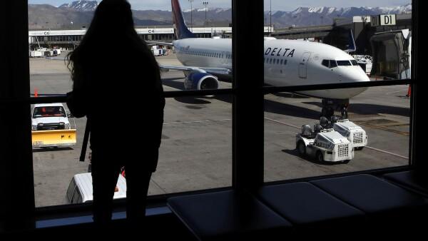A woman waits for a flight  at Salt Lake City International Airport in Salt Lake City