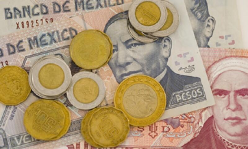 Analistas prevén que el peso alcance las 15 unidades por dólar en 2015. (Foto: Getty Images )