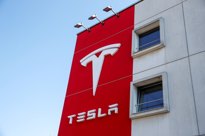 FILE PHOTO: Logo of Tesla is seen at a branch office in Bern
