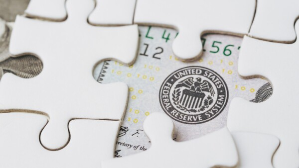 FED strategy of interest rate hike, United States of America financial or economics concept, jigsaw or puzzle reveals US Federal Reserve emblem on US dollar bill