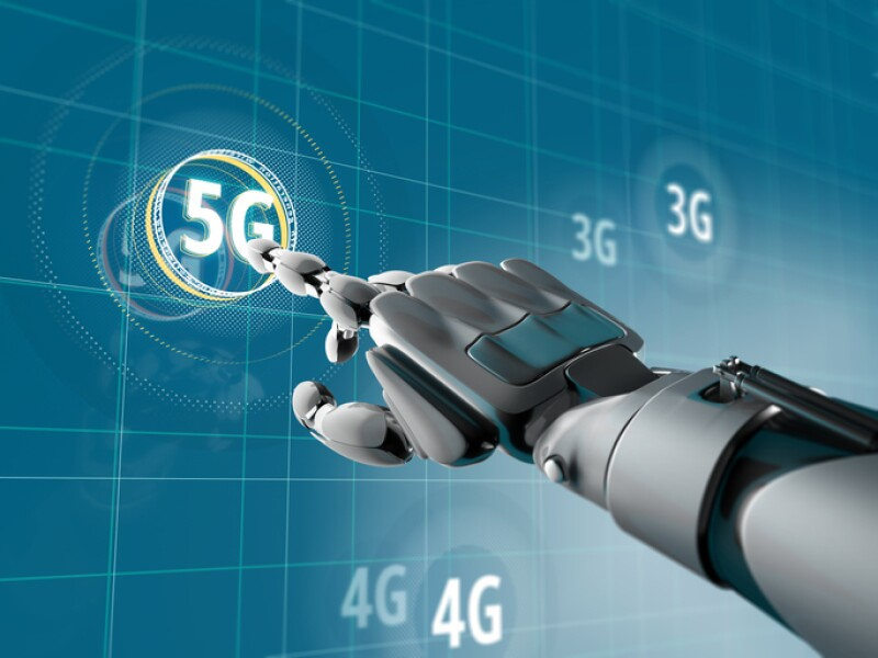 A robotic hand pick on a symbol of 5G on Sci-fi interface with HUD elements. Futuristic concept of wireless communication