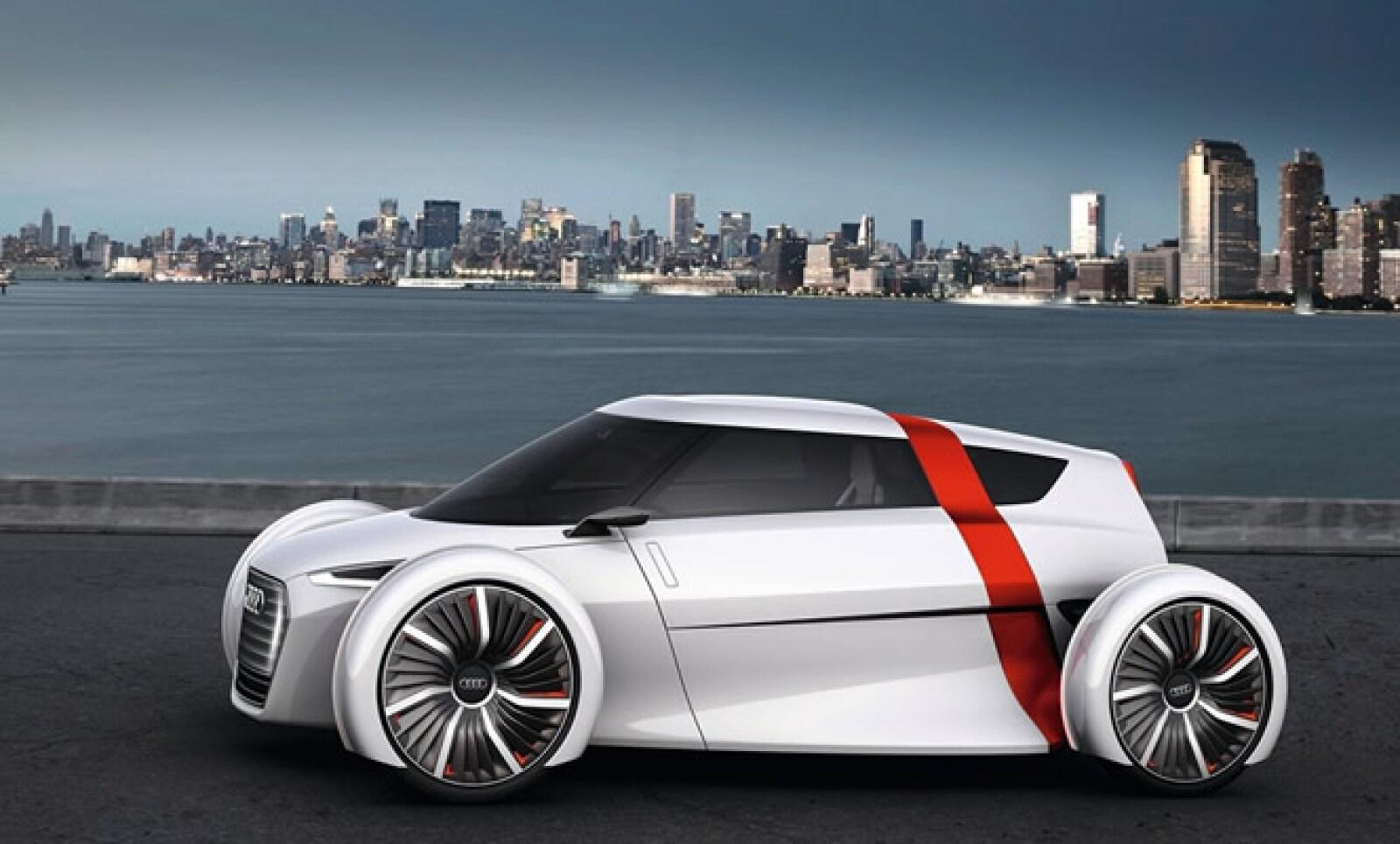 Vehículo urbano eléctrico en configuración 1+1 (conductor más un acompañante), fabricado en fibra de carbono para mantener el peso en apenas 480 kg.