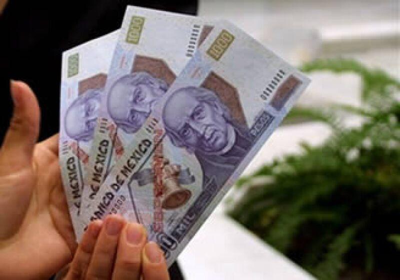 Alfredo Coutiño, director de Moody's Economy.com, descartó riesgos de recaída para las economías de EU y México. (Foto: AP)