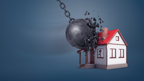 3d rendering of a giant wrecking ball breaks in small pieces when hits a small family house