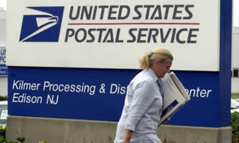 Los sindicatos dicen que los pagos de la asistencia sanitaria son la principal causa de los problemas financieros del Servicio Postal. (Foto: AP)