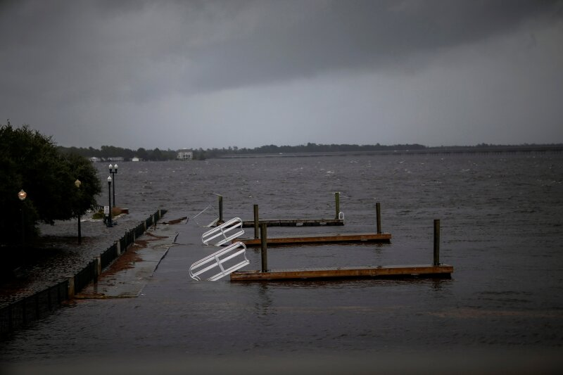 Docks broken by water from Neuse River are seen floating as Hurricane Florence comes ashore in New Bern, North Carolina