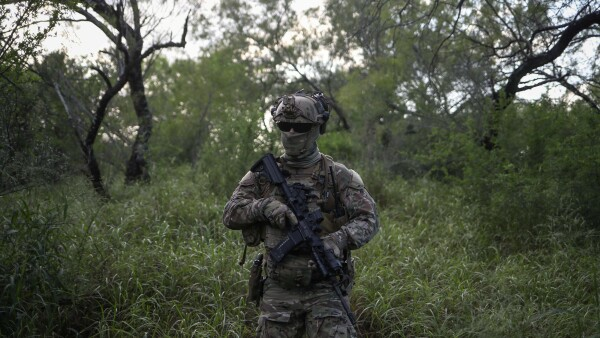 An agent with the U.S. Border Patrol Tactical Unit guards the U.S. side of the border with Mexico in Fronton, Texas